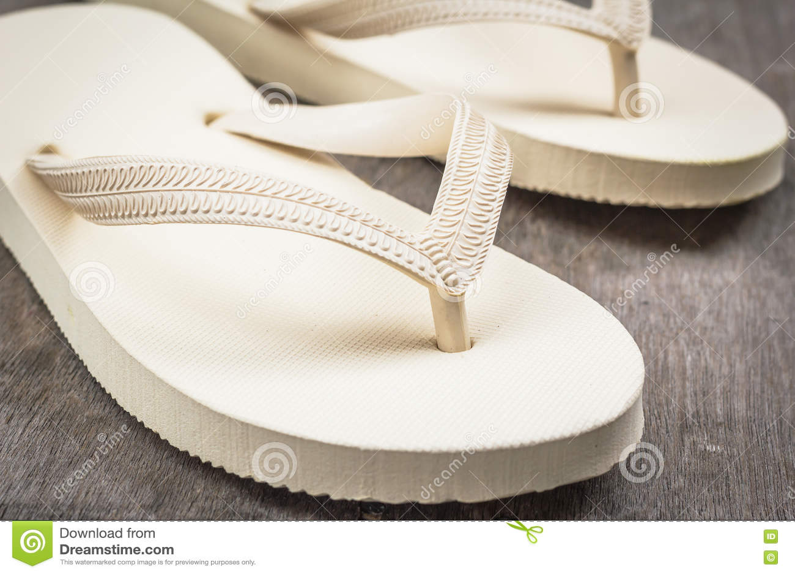 Flip-flops cream color.