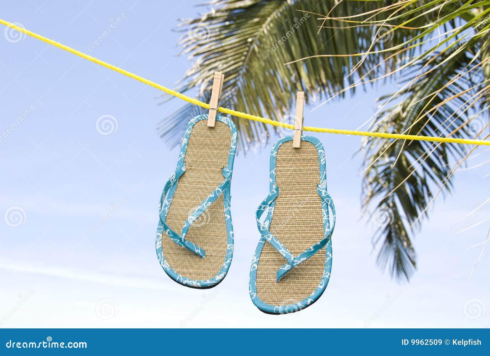 6bfe9d0046b972 Flip Flops Hanging On Clothesline Stock Image - Image of tropical ...