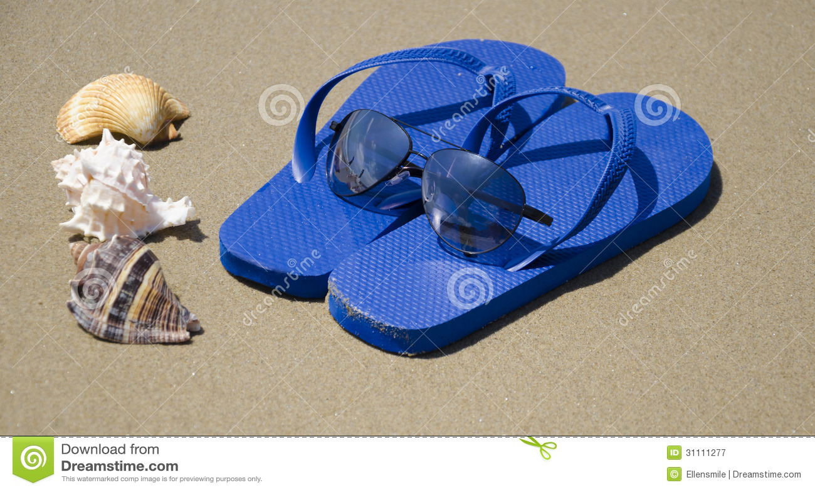 Flip flops on a sand
