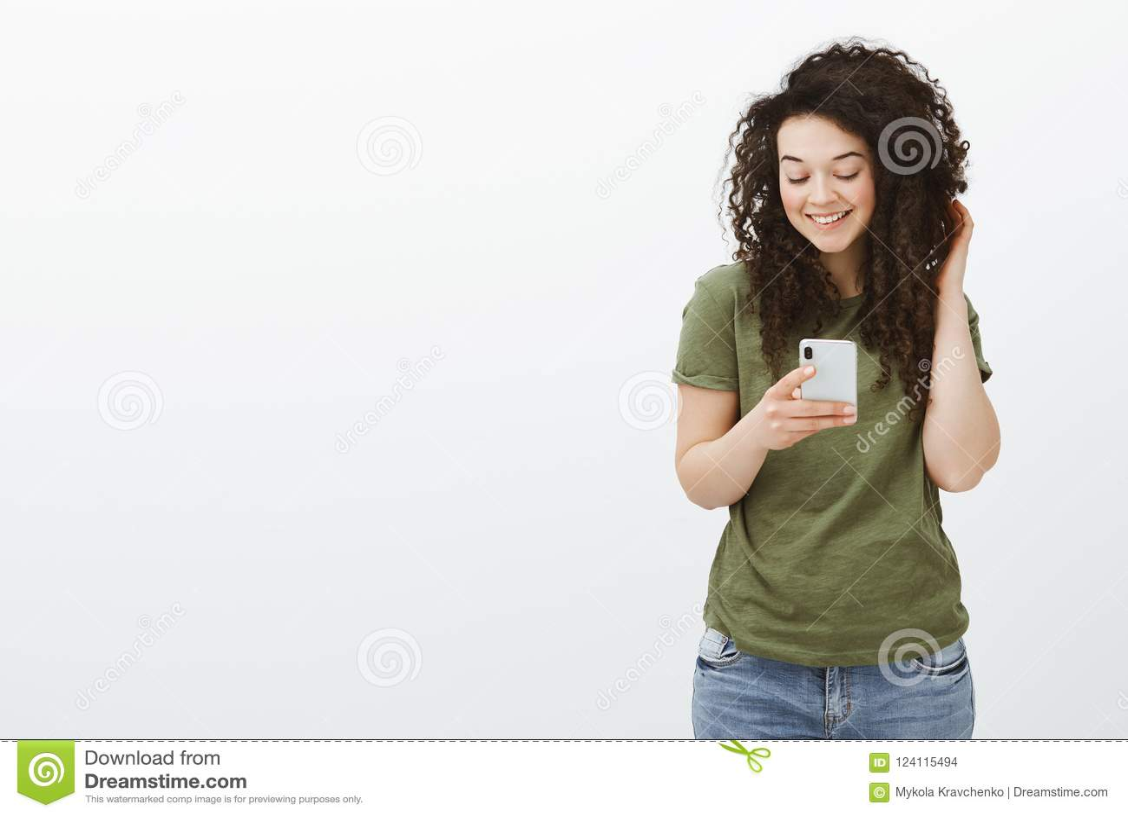 Flirty Beautiful Curly-haired Girl In Dark-green T-shirt, Touching