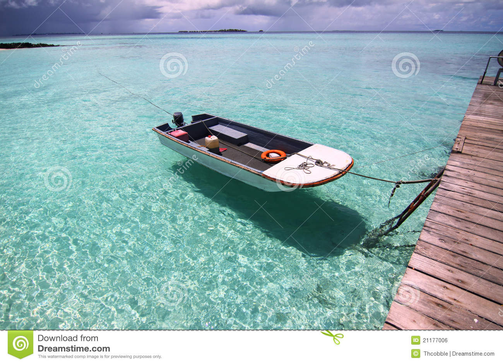 Floating boat on the blue sea, Maldives