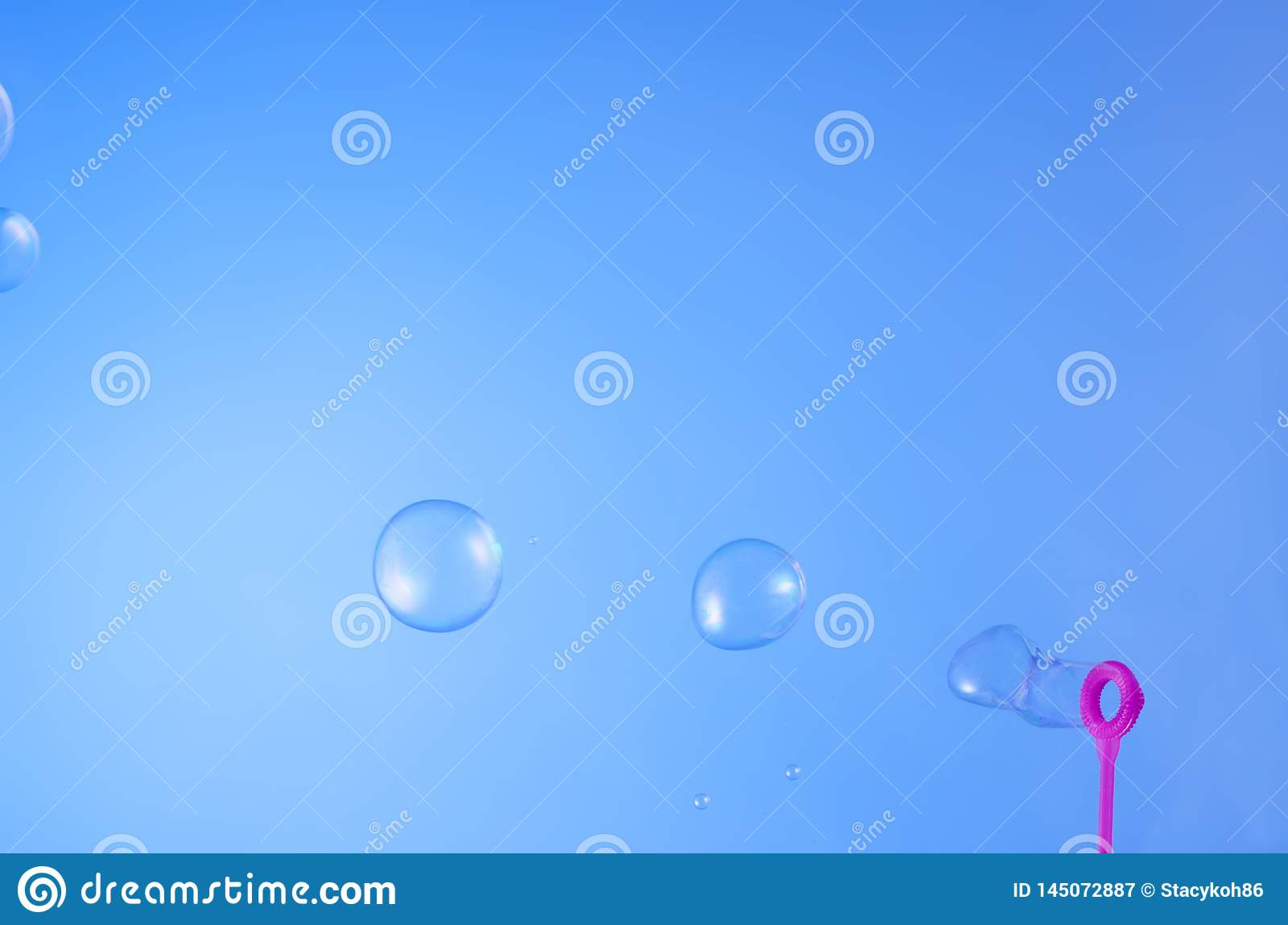 Floating bubble soap in the blue sky