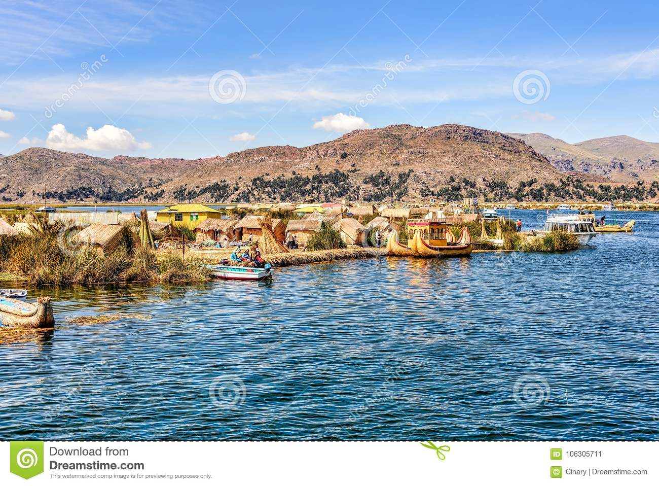 Floating islands made from reeds on Lake Titicaca under blue ski
