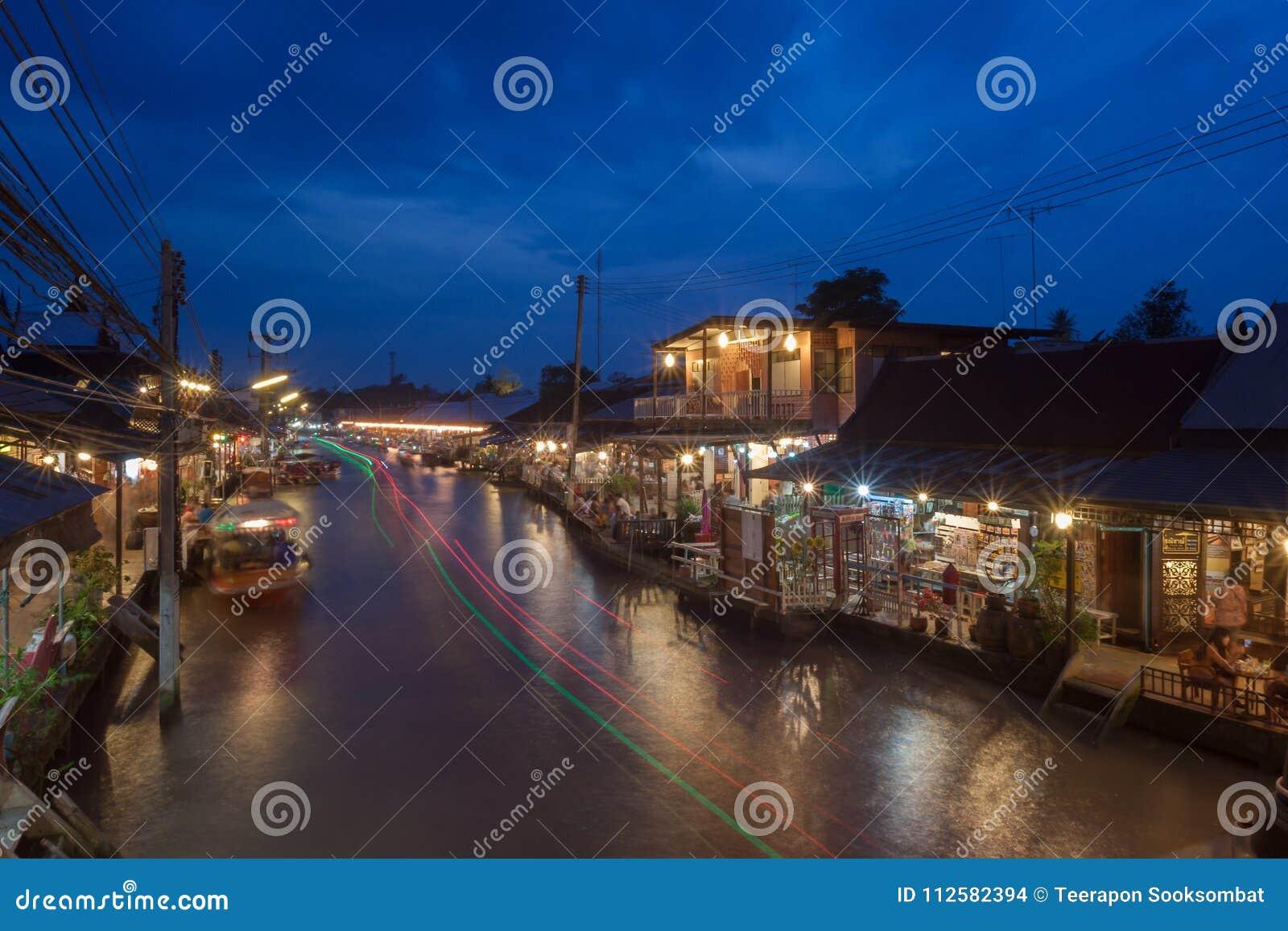 Floating market at night in Amphawa, Samut Songkhram , Thailand.