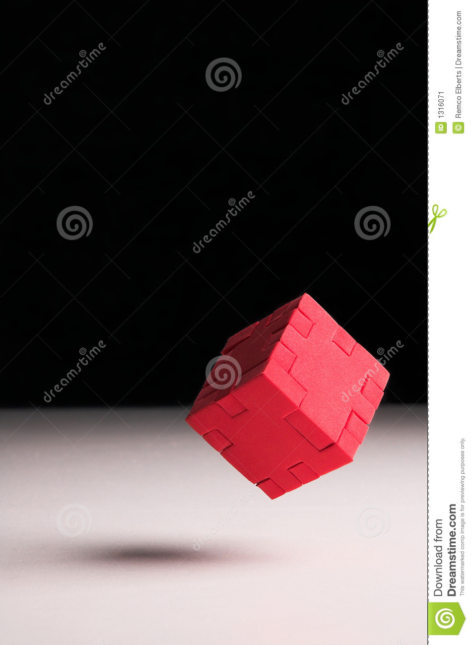 Floating red puzzle cube
