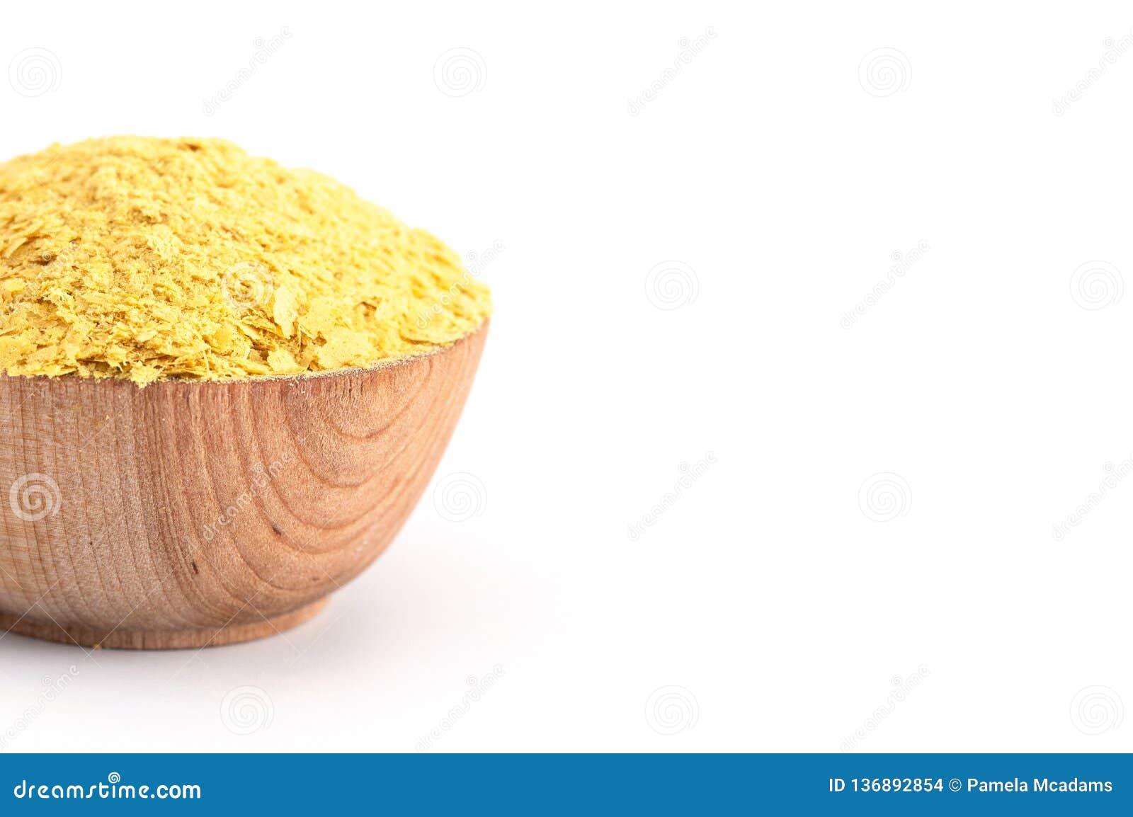 Flocons de levure nutritionnelle jaune un substitut de fromage et assaisonnement pour des régimes de Vegan
