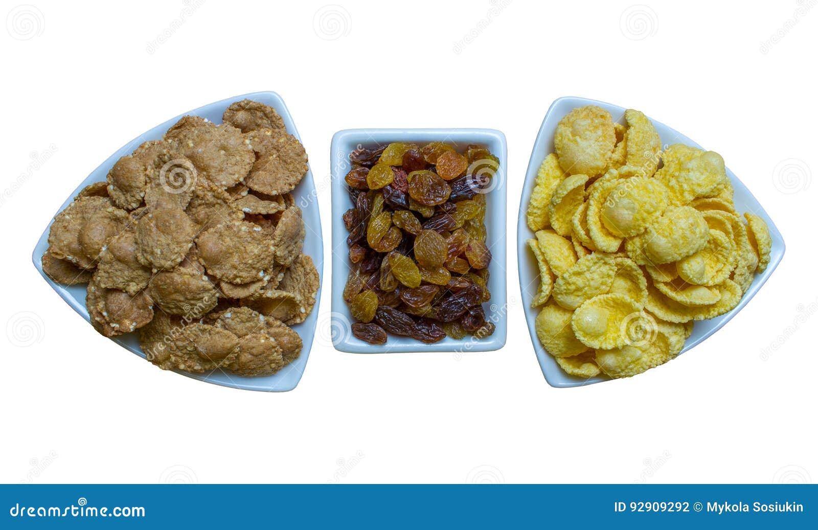 Flocos de milho com passa, café da manhã da aptidão
