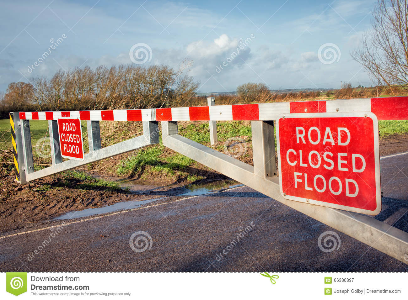 Flood road closed warning sign on barrier stock image