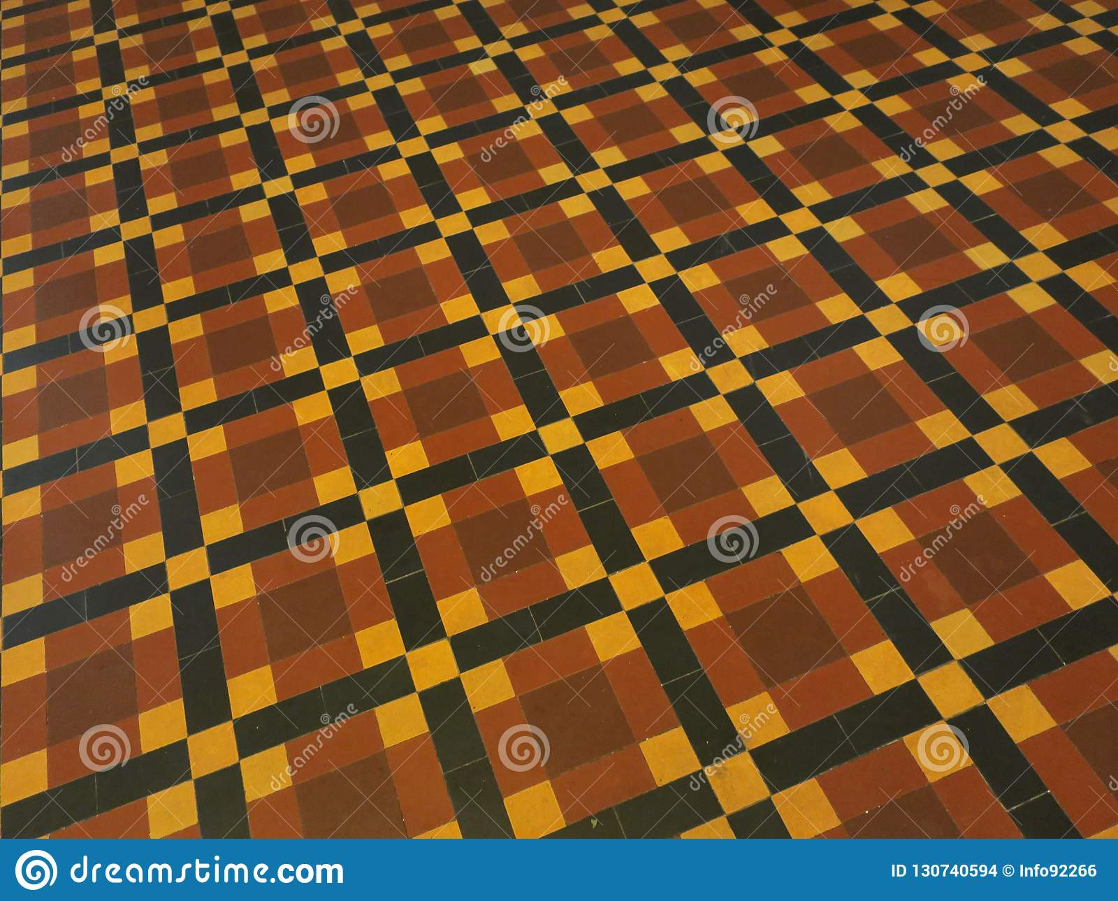 Floor with pattern in a red, yellow and black tiles