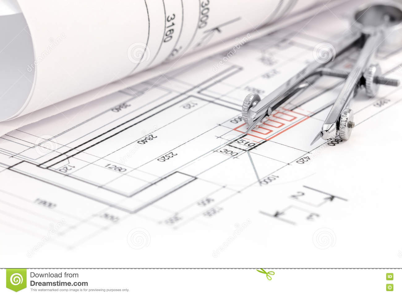 floor plan with rolled blueprint and drawing compass stock photo