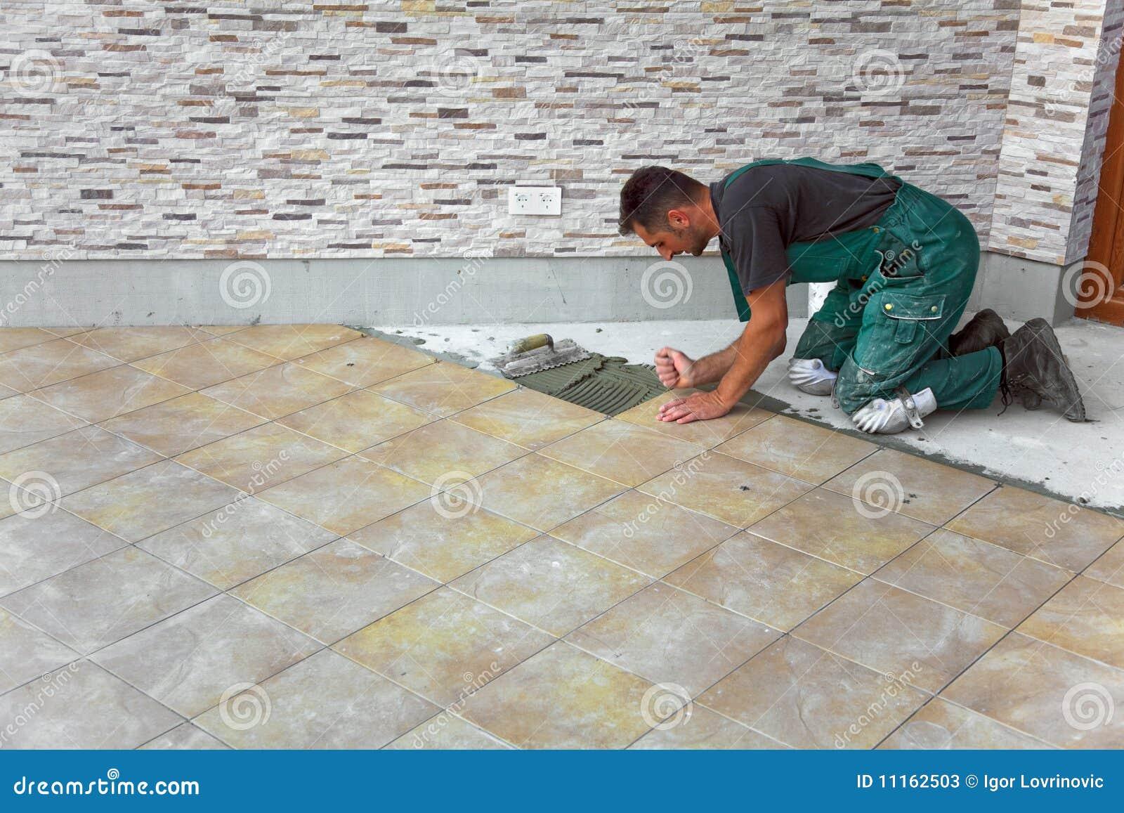 Floor Tile Construction : Floor tiles installation stock image of