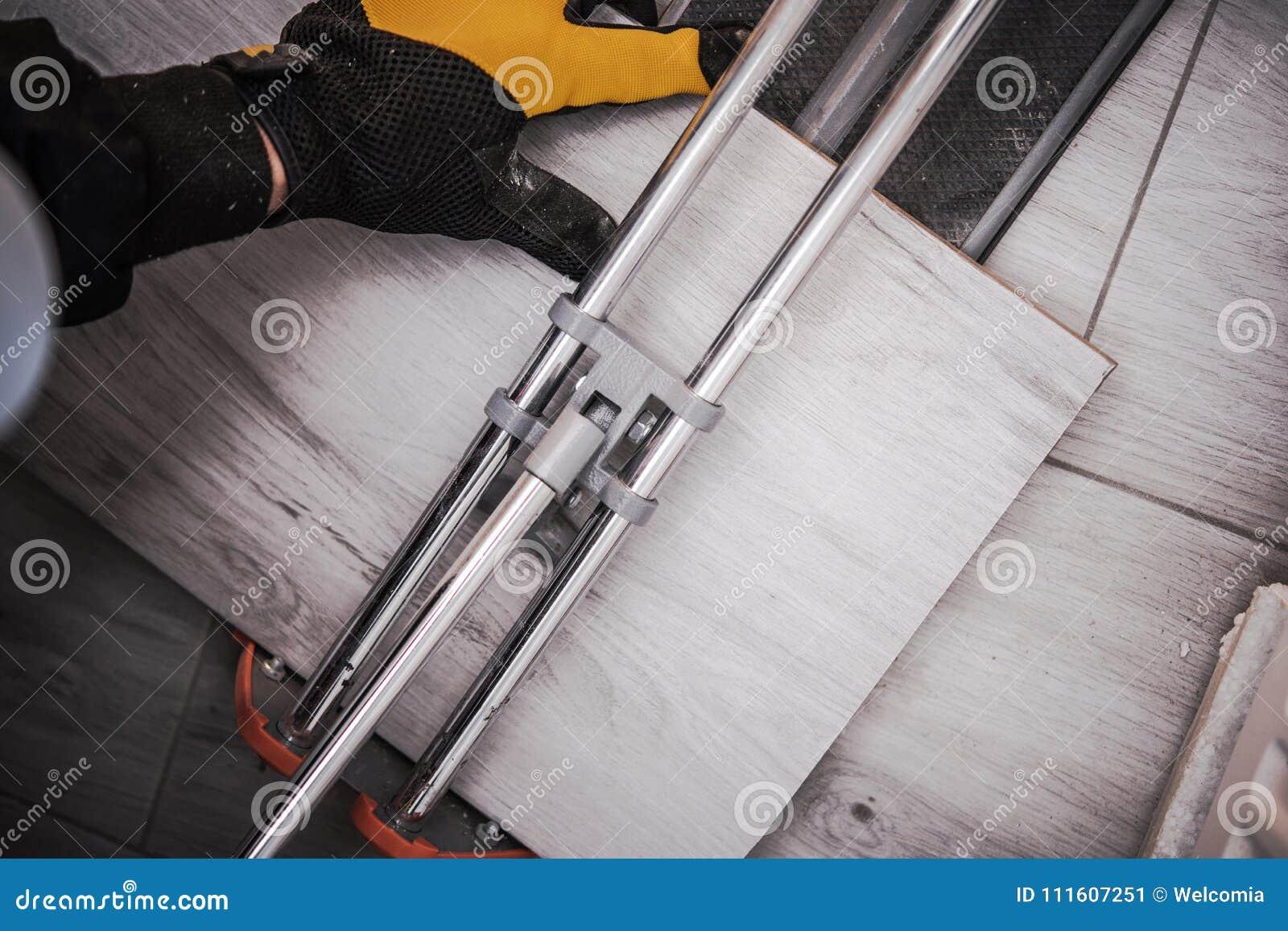 Floor Tiles Installation stock image. Image of worker - 111607251