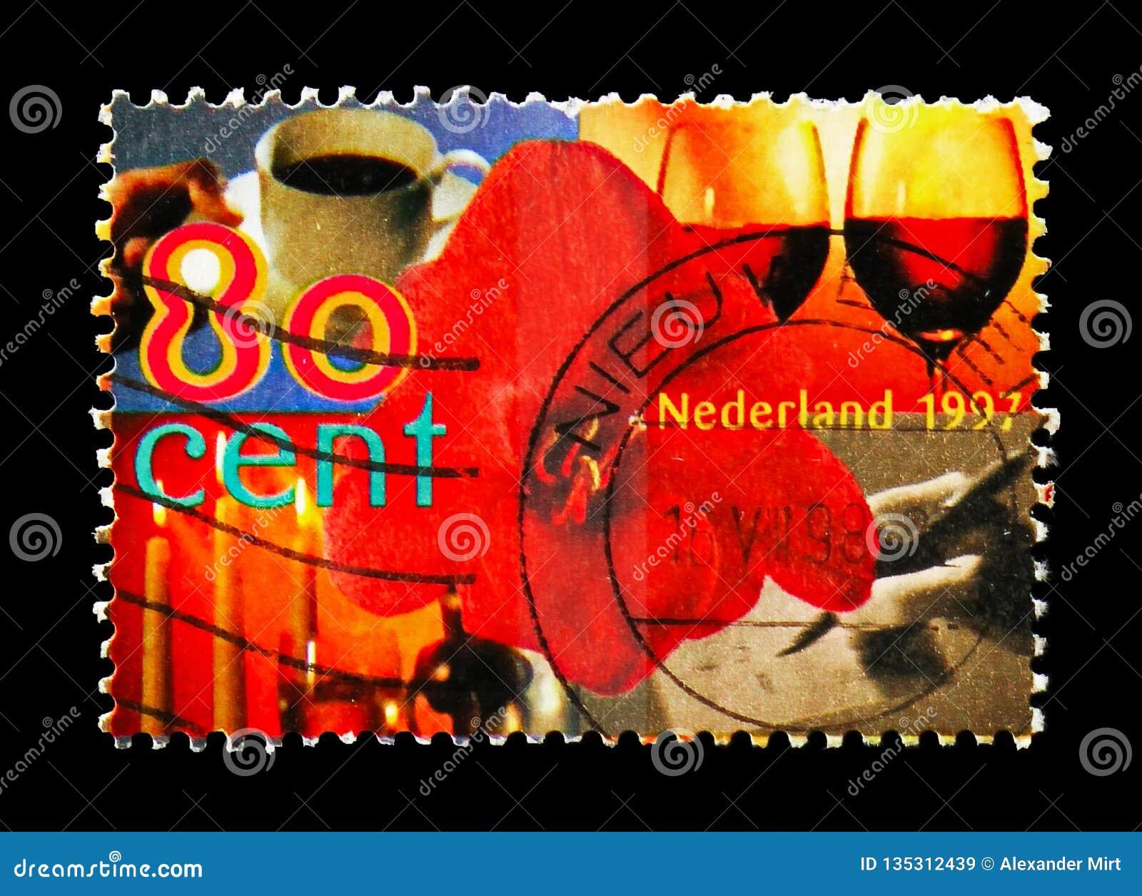 Flor, copo de café, vidro de vinho, velas e mão da escrita, serie dos selos dos cumprimentos, cerca de 1997