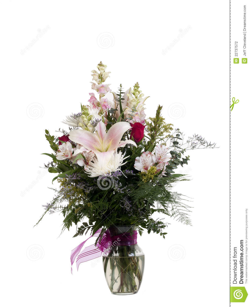 Floral arrangement in clear glass vase ribbon stock