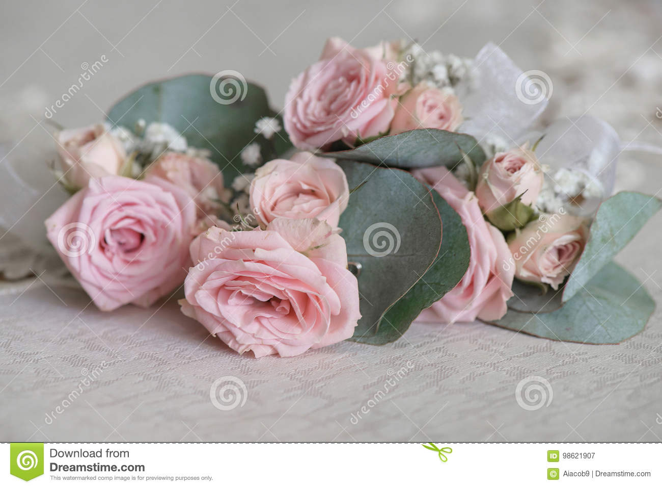 Withered dusky pink roses and over sized leaves bouquet on a table download withered dusky pink roses and over sized leaves bouquet on a table after mightylinksfo
