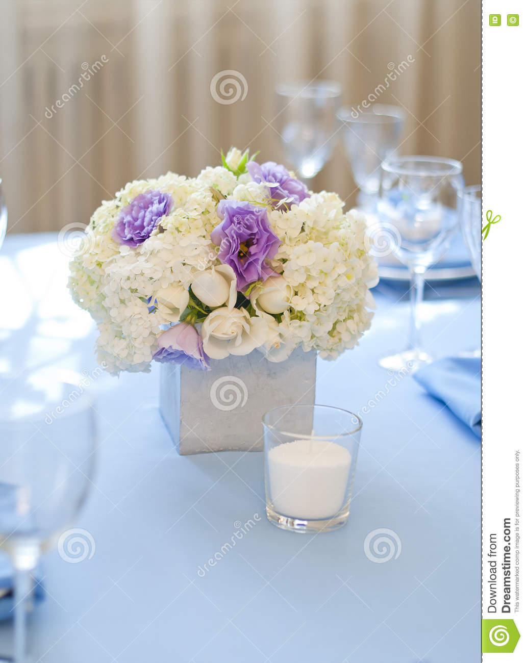 Floral Arrangement With White And Blue Flowers And Candles Stock