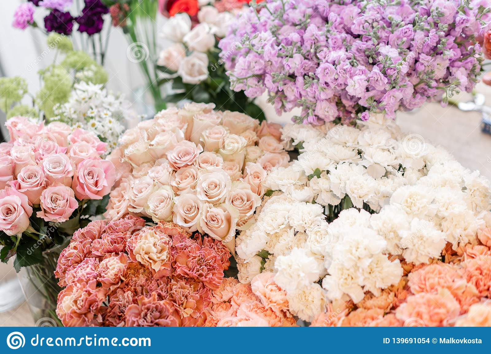 Floral carpet, flower texture, shop concept. Beautiful fresh blossoming flowers roses, spray roses, lilac gillyflower
