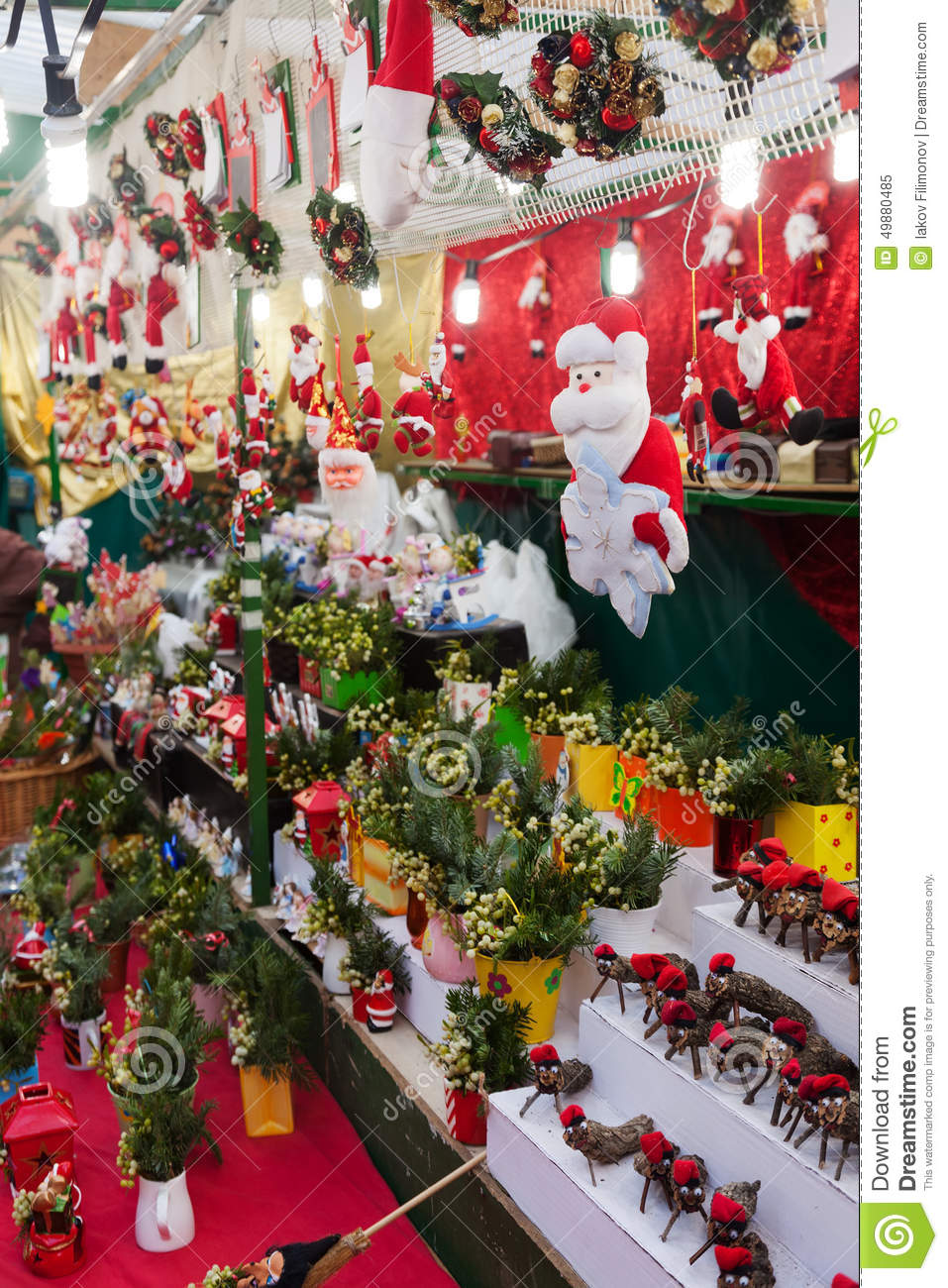 floral decorations and traditional gifts in christmas market