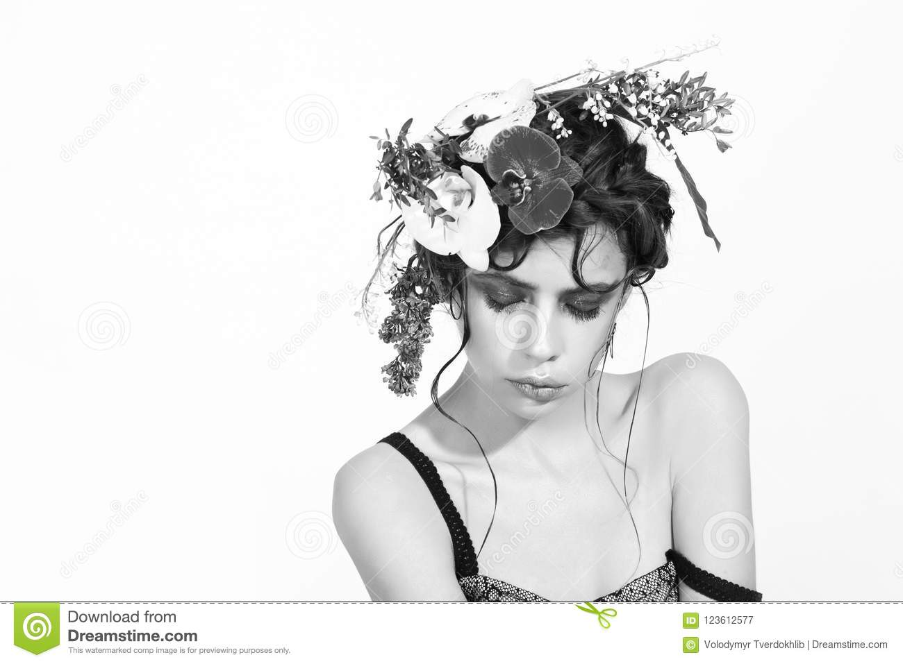 Girl With Stylish Makeup And Natural Flowers In Hair Stock Image