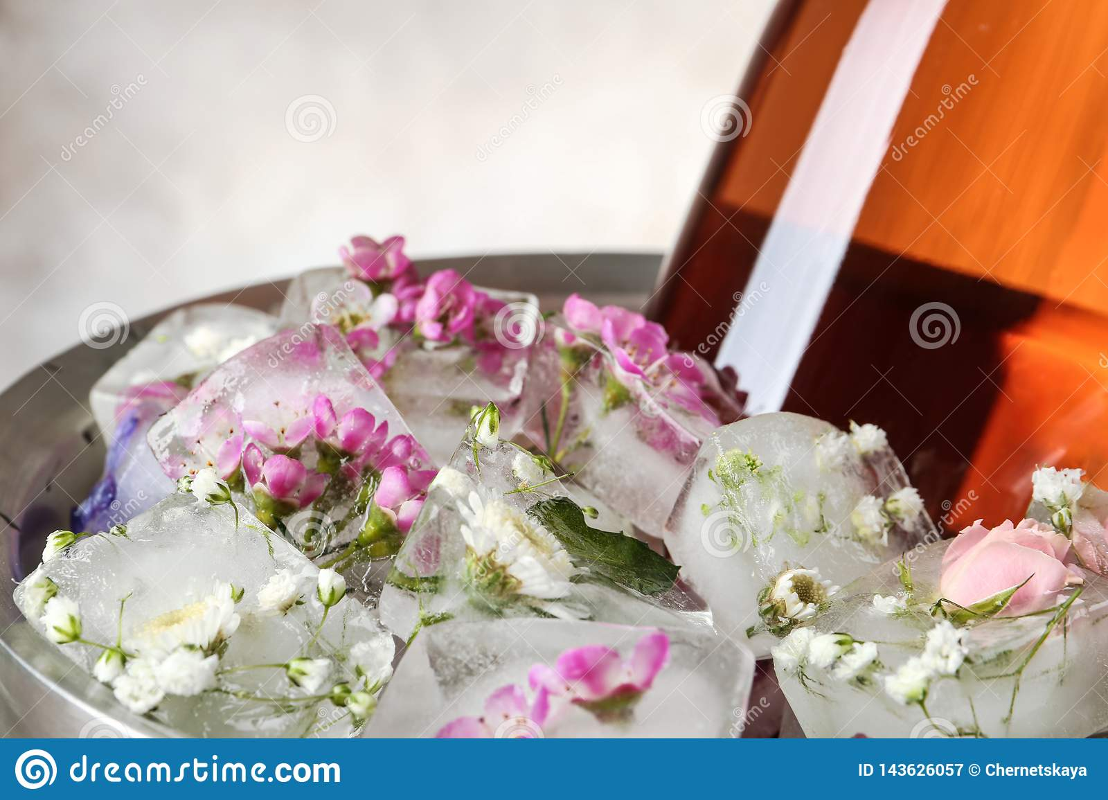 Floral Ice Cubes And Bottle Of Champagne In Bucket Stock Image Image Of Festive Light 143626057