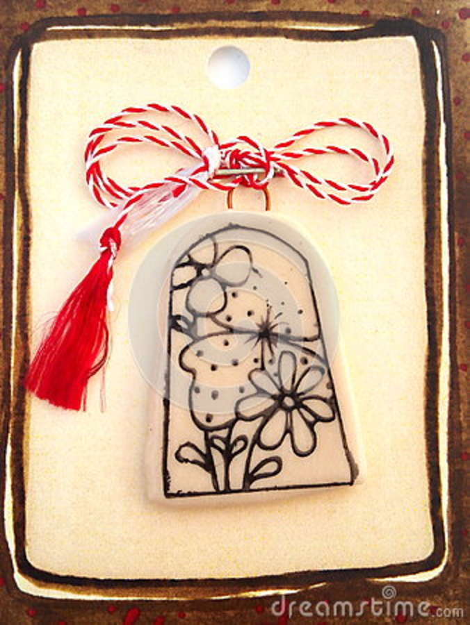 Floral medallion with red and white string.