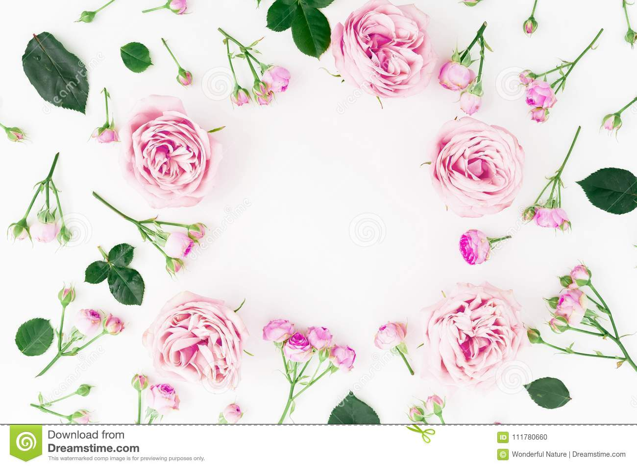 Floral round frame with pastel roses and leaves on white background. Flat lay, top view. Frame background