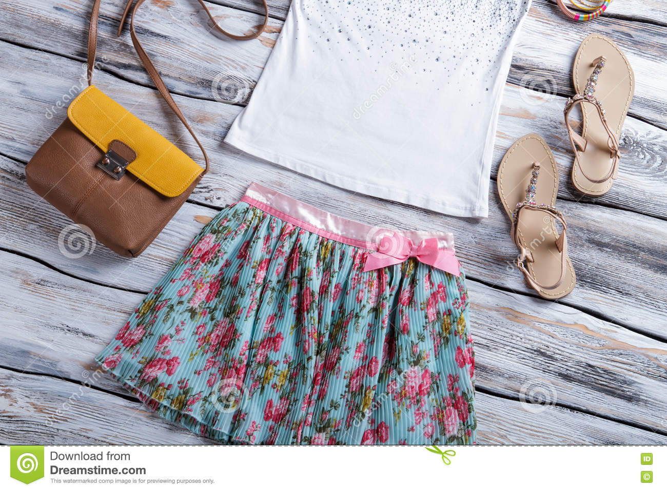23e85ff2fd41 Floral skirt and white top. Top with sandals and purse. Trendy bicolor purse  on sale. Selection of girl s summer clothing.
