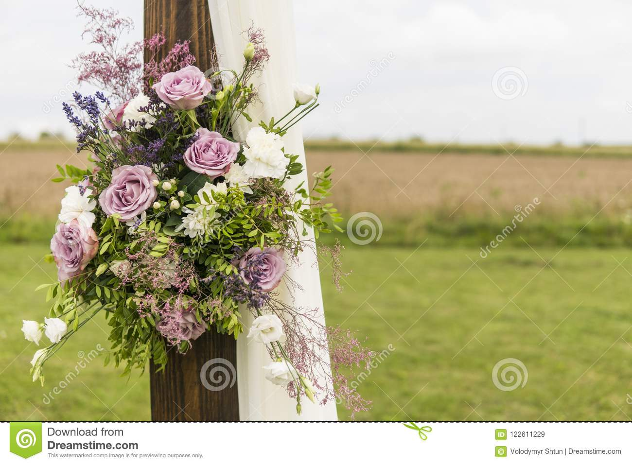 Floral Wooden Arch With White Cloth And Fresh Violet Pink White