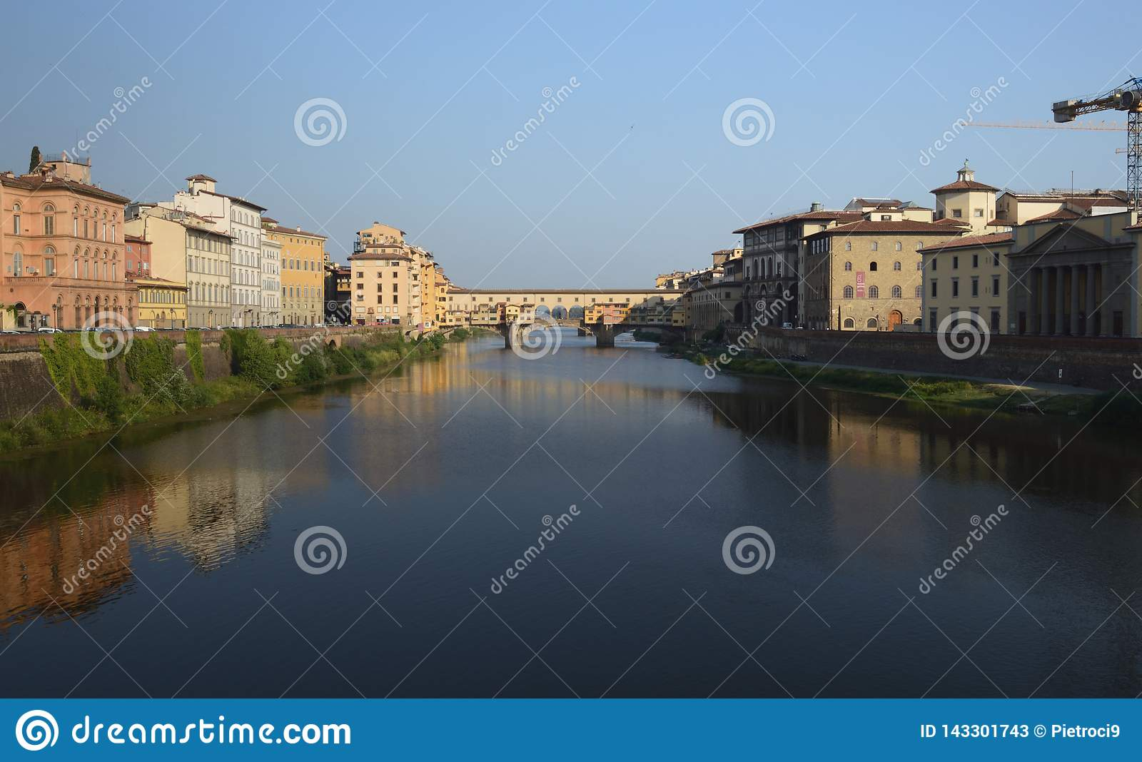 Florence is reflected in the Arno river.