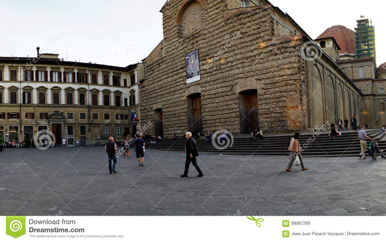 People walking in front of the Basilica called `San Lorenzo` in the place called San Lorenzo