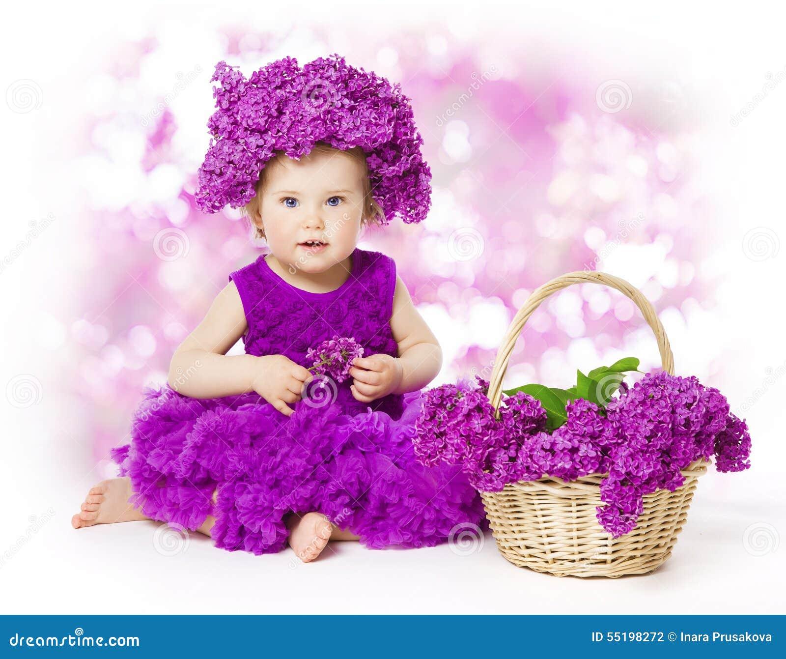 Flores de la lila del bebé, niño en la flor, ramo del niño