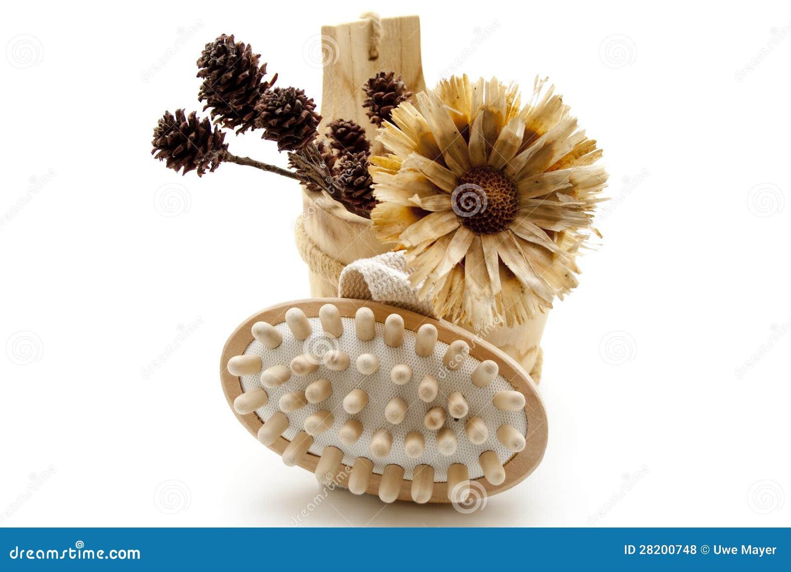 Flores e escova secas da massagem