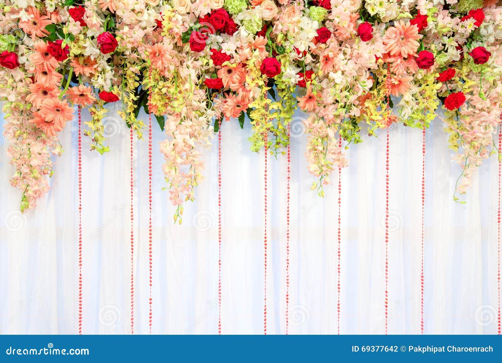 Flores e fundo bonitos da parede de cortina da onda - casamento cer