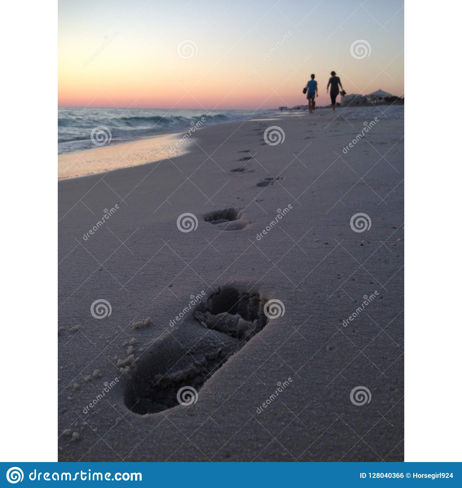 Florida Beach Sunset with People and Footprints in Sand