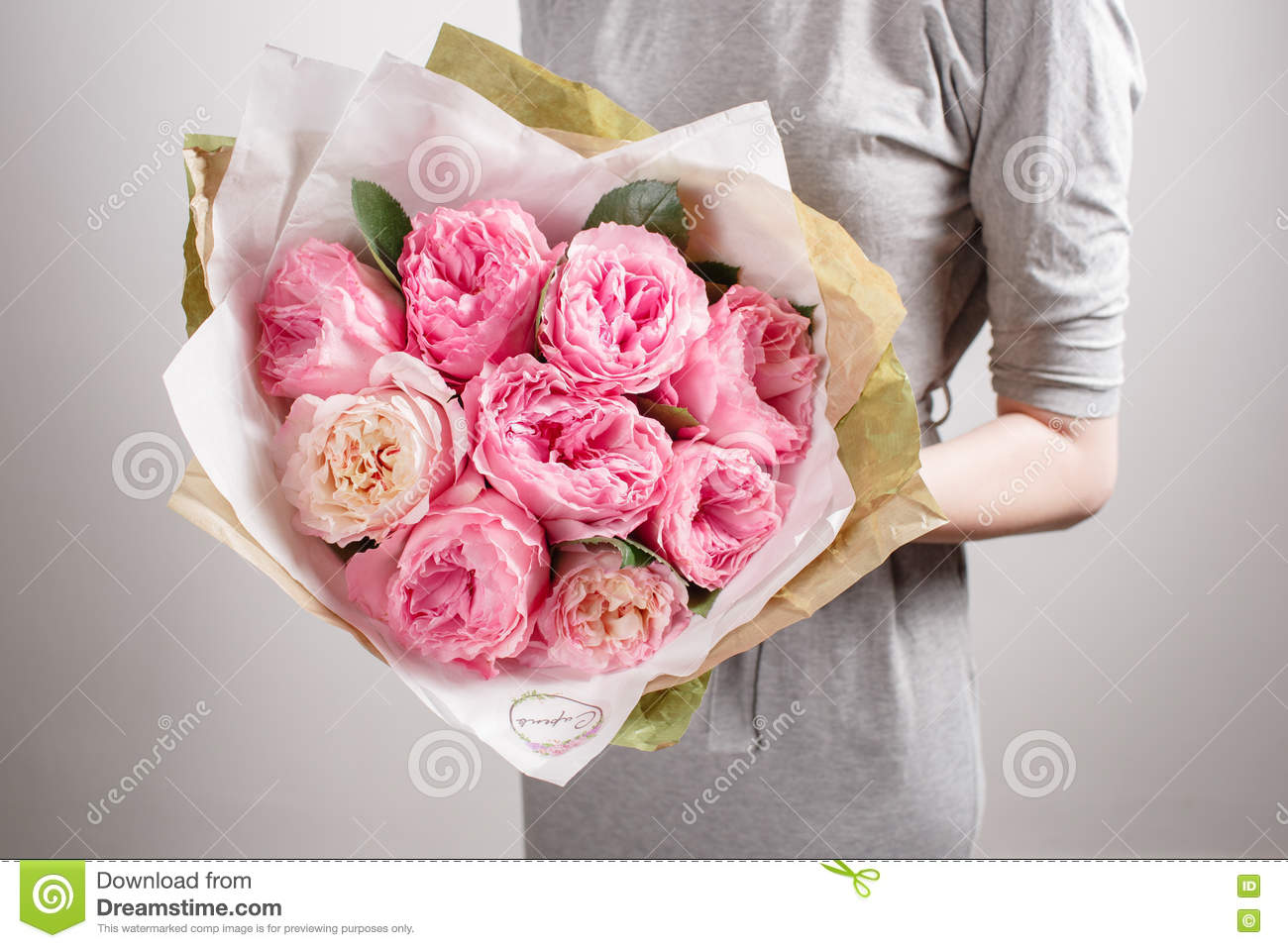 Florist Girl With Peony Flowers Or Pink Garden Roses Young Woman