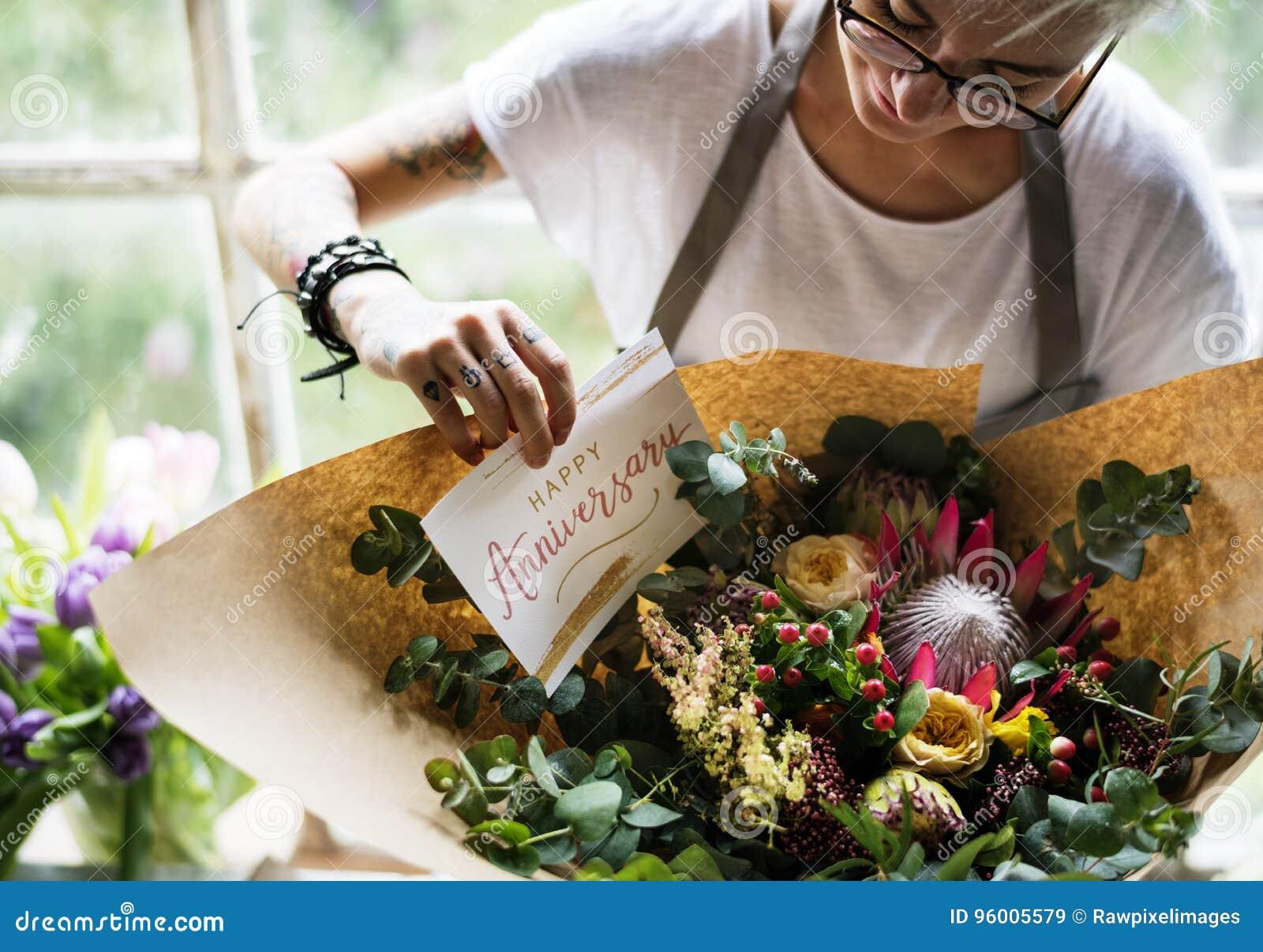 Florist Making Fresh Flowers Bouquet Arrangement With Happy Anni