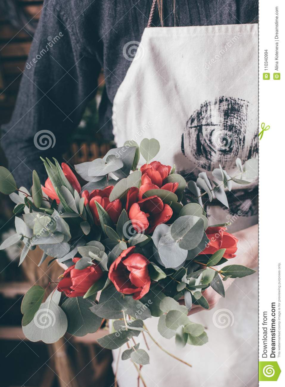 Young florist woman making beauty bouquet stock photo image of florist woman making flower bouquet on her workplace izmirmasajfo