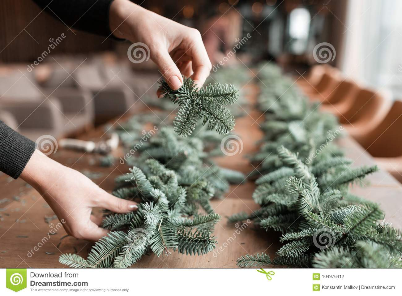 download florist at work woman hands making christmas decorations garland of fir happy new