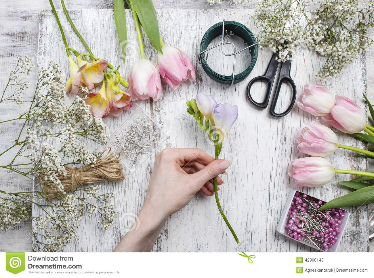 Florist at work woman making bouquet of spring freesia flowers woman making bouquet of spring freesia flowers stock photo image izmirmasajfo