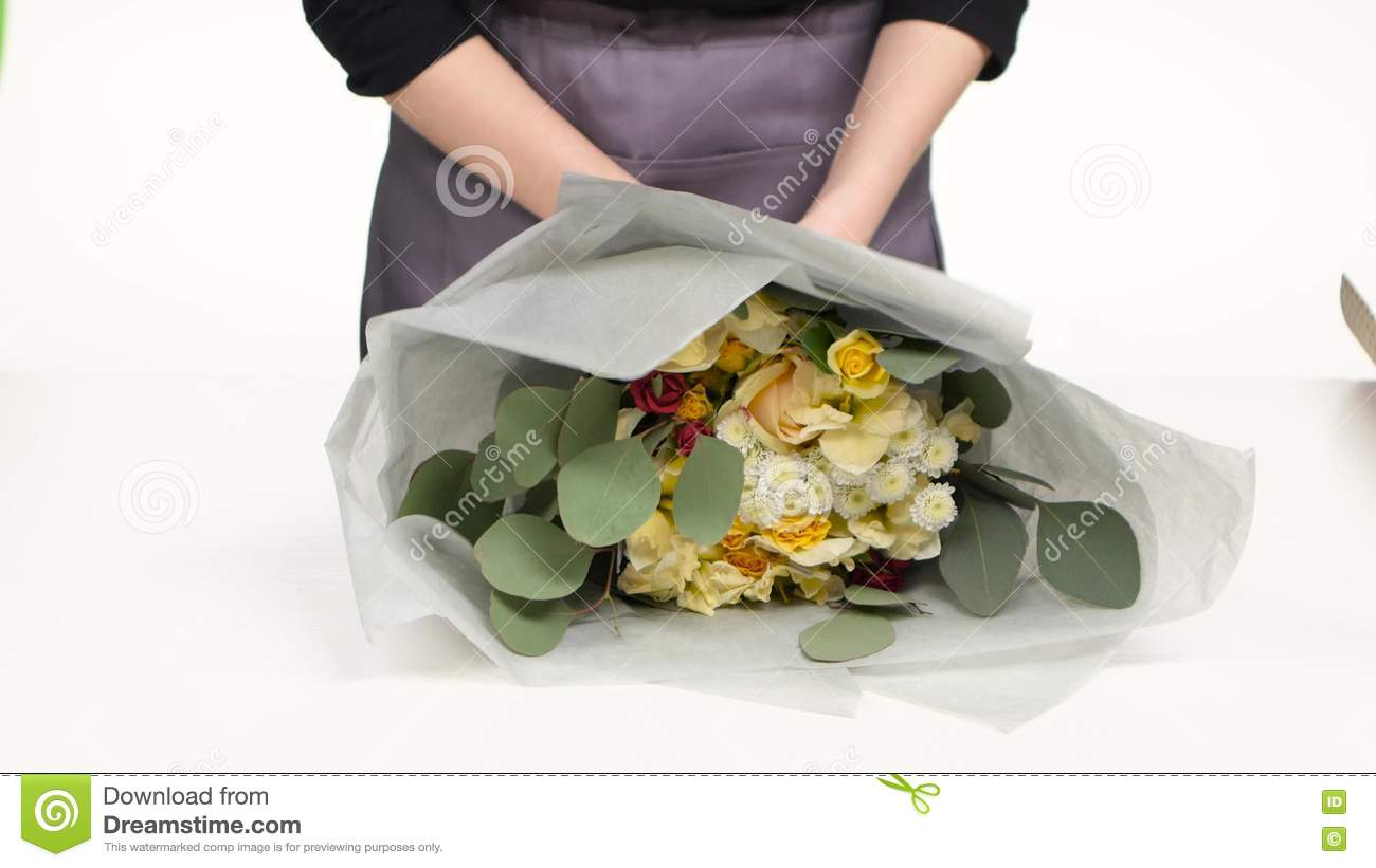 Florist Wrapping For Bouquet Flowers. White. Close Up Stock Footage ...