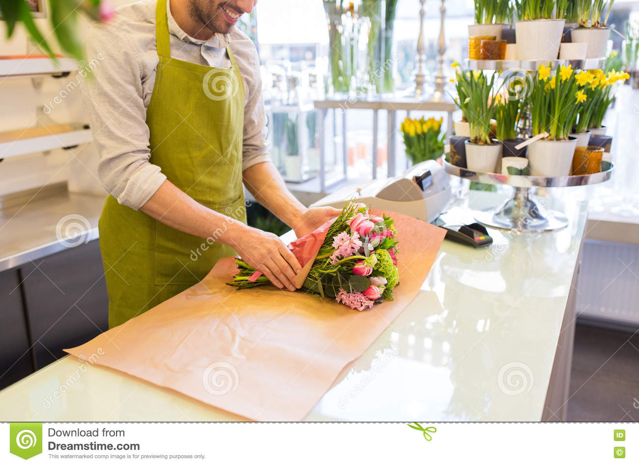 Florist wrapping flowers in paper at flower shop stock image image florist wrapping flowers in paper at flower shop mightylinksfo