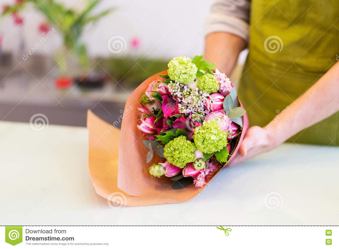 Florist wrapping flowers in paper at flower shop stock image image download comp mightylinksfo
