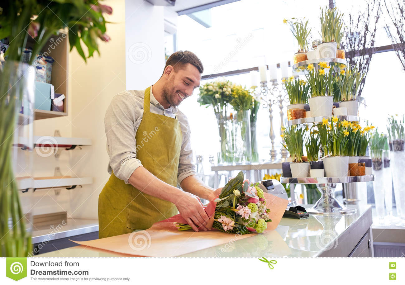 Florist Wrapping Flowers In Paper At Flower Shop Stock Photo Image