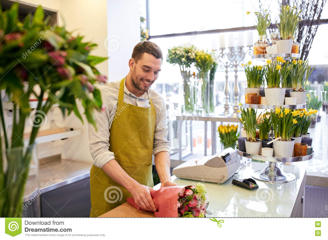 Florist Wrapping Flowers In Paper At Flower Shop Stock Image Image