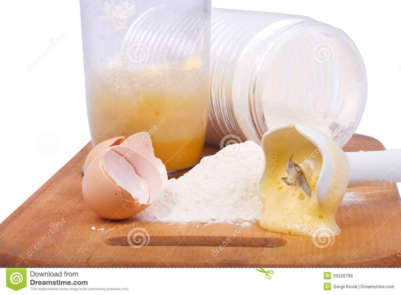 Beat Eggs With A Hand Blender ~ Flour and beaten egg blender royalty free stock images