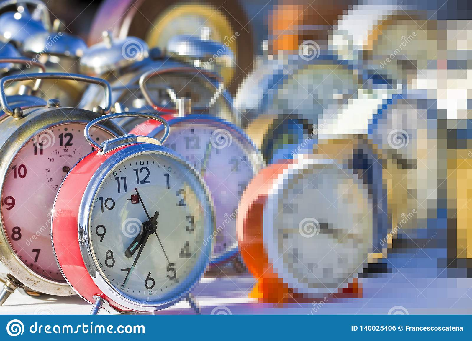Flow of time is just an illusion - concept image with old colored metal table clocks