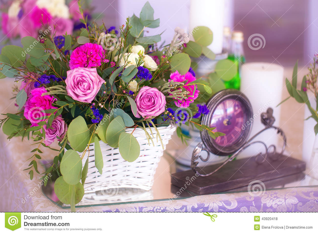 flower arrangement in a basket decorate the wedding table. Black Bedroom Furniture Sets. Home Design Ideas