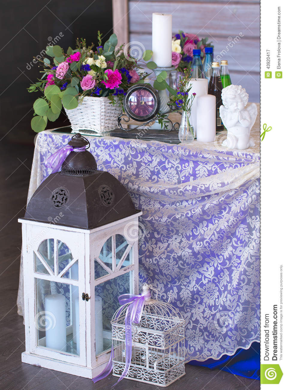 Flower Arrangement In A Basket Decorate The Wedding Table