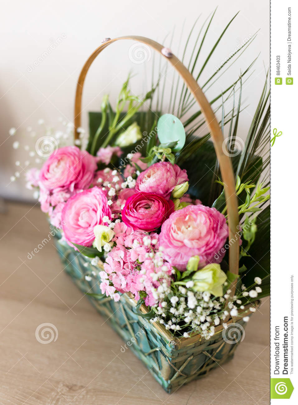 Flower arrangement in basket with ranunculus and small pink and download flower arrangement in basket with ranunculus and small pink and stock image image of mightylinksfo