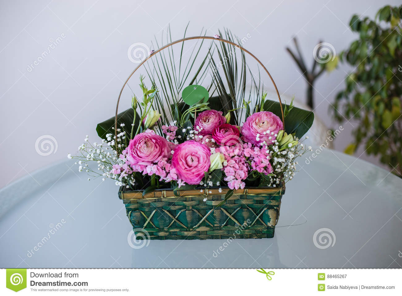 Flower arrangement in basket with ranunculus and small pink stock front view of flower arrangement in basket with dark and light pink ranunculus and austeria mightylinksfo